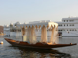 Fototapety Small boat in Udaipur, India