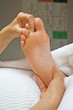 Reflexologist working on second toe