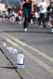 Bottle of water at a marathon poster