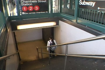 Woman Enters Subway in New York City