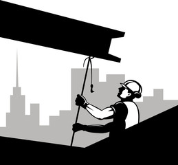 Construction worker hoisting an i-beam