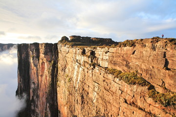 Sheer cliffs of Mount Roraima - landscape with clouds background