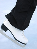 White skate. Woman at the handmade rink