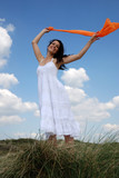 Happy woman holding orange sarong poster