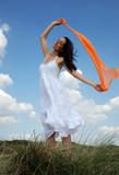 Beautiful woman with orange sarong poster