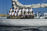 Sailing crew posing for a group portrait on board yacht