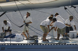 Crew working on yacht, side view