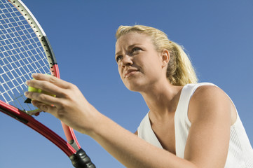 Female Tennis Player Preparing to Serve, low angle view, close up