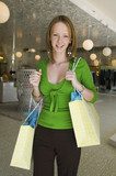 Girl Holding Shopping Bags in Boutique, portrait