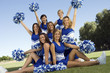 Cheerleaders posing on lawn, portrait