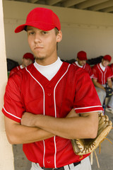 Young baseball player on field, portrait