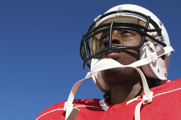 Football Player wearing helmet on outside, low angle view, close-up, close-up, low angle view