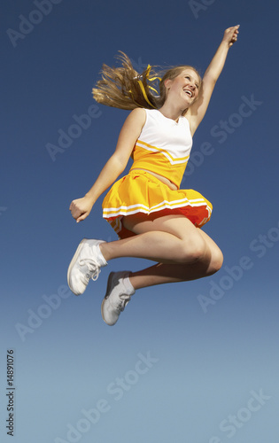 Cheerleader jumping, mid-air, low angle view, low angle view