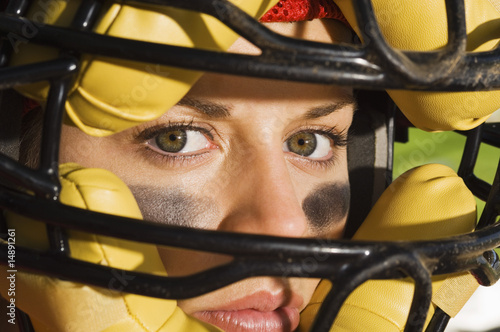 Softball player wearing helmet, close-up of face