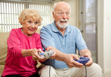 Senior Couple Play Video Games poster