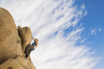Woman Free Climbing on Rocks