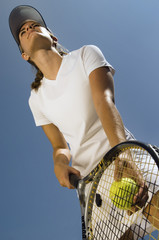 Tennis Player holding ball and racket Preparing to Serve, low angle view