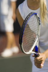 Tennis Player holding racket, Waiting For doubles partner to Serve, close-up, mid section