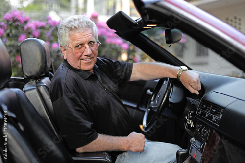 Old man in his cabriolet