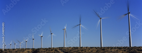 Wind turbines against blue sky