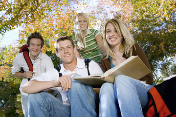Students studying outdoors, portrait