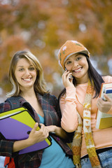 Two female students, outdoors, portrait