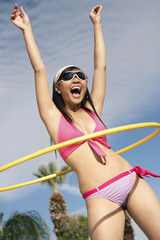 Young woman in bikini with hoop