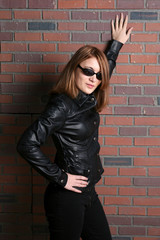 pretty and tough looking teen in black leather