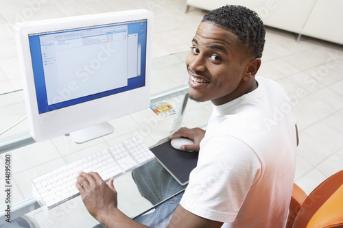 Man sitting at computer, elevated view