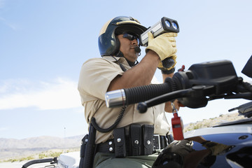 Police officer using radar gun