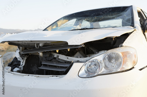 Front end of wrecked car on desert highway