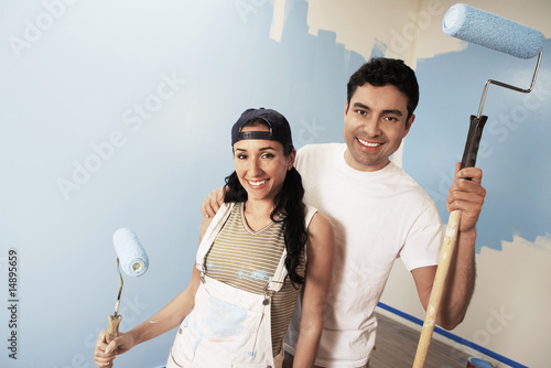 Couple with paint rollers, portrait