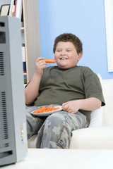 Boy Eating Carrot Sticks