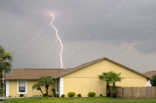 Daytime lightning strike near homes during afternoon storm