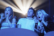 Young People screaming, watching Horror Movie in Theatre
