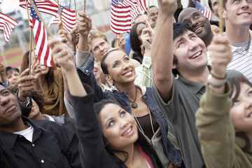 People holding up American Flags