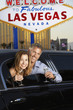 Couple sitting in limousine with drinking glasses in front of Welcome to Las Vegas sign
