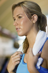 Woman with towel at gym, close-up