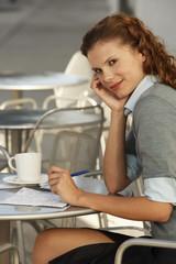 Businesswoman at Sidewalk Cafe