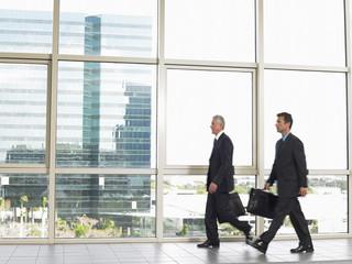 Businessman walking by office window