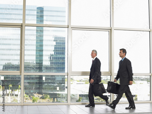 Businessman walking by office window