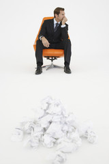 Pensive Businessman With Waste Paper