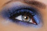 eye with bright blue eyeshadow poster