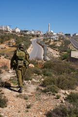 Israeli soldiers patrol in palestinian village