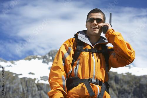 Man using walkie-talking on mountain peak