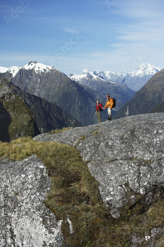 Two hikers in mountains