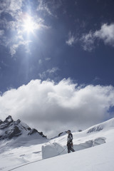 Mountain climber standing on snowy slope