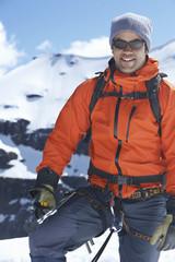 Mountain climber on top of peak