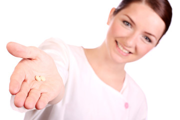 Beautiful nurse offering two pills
