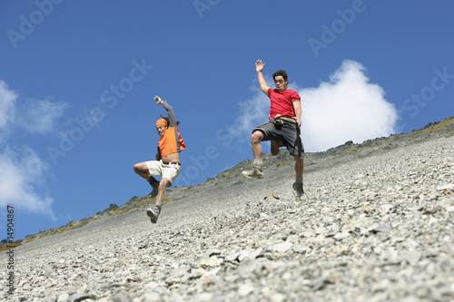 Two men jumping down screen field